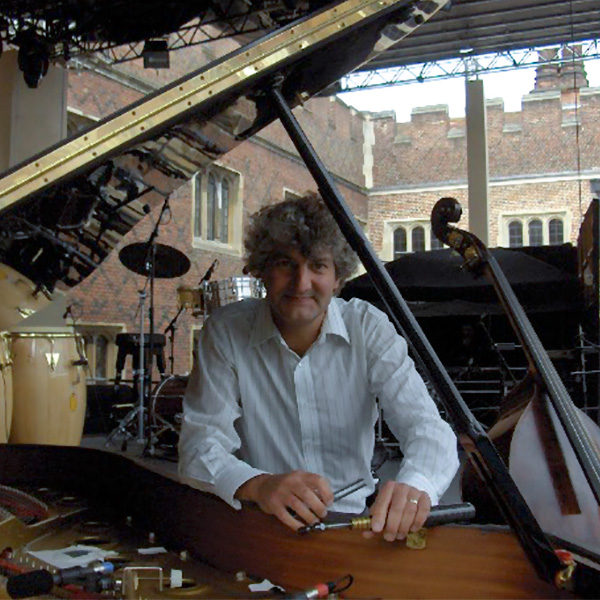Tim Hendy tuning a grand piano for the Hampton Court Festival