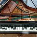 Bechstein Model B grand piano lid open with keyboard, desk, frame, soundbard, strings and case