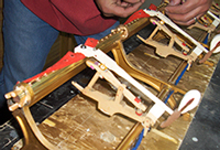 Tim Hendy Pianos workshop, new Steinway action rail wedged temporarily in place