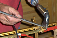 Tim Hendy Pianos workshop, new Steinway action rail soldered into position